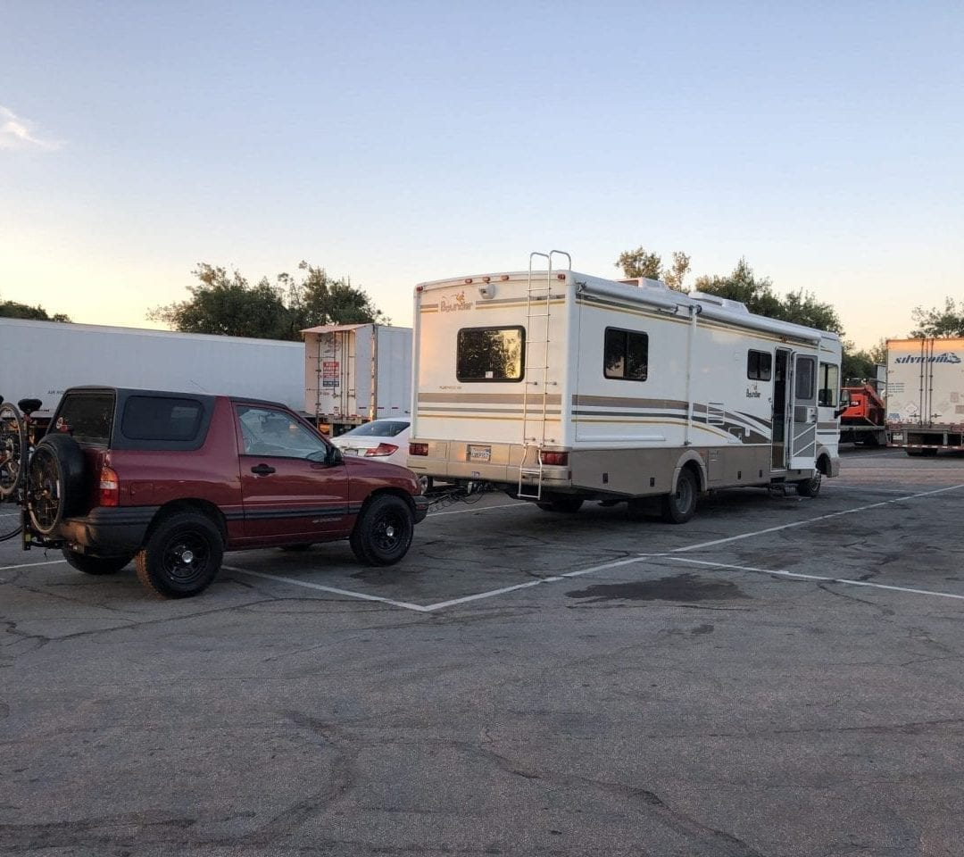 Bounder RV towing Chevy Tracker