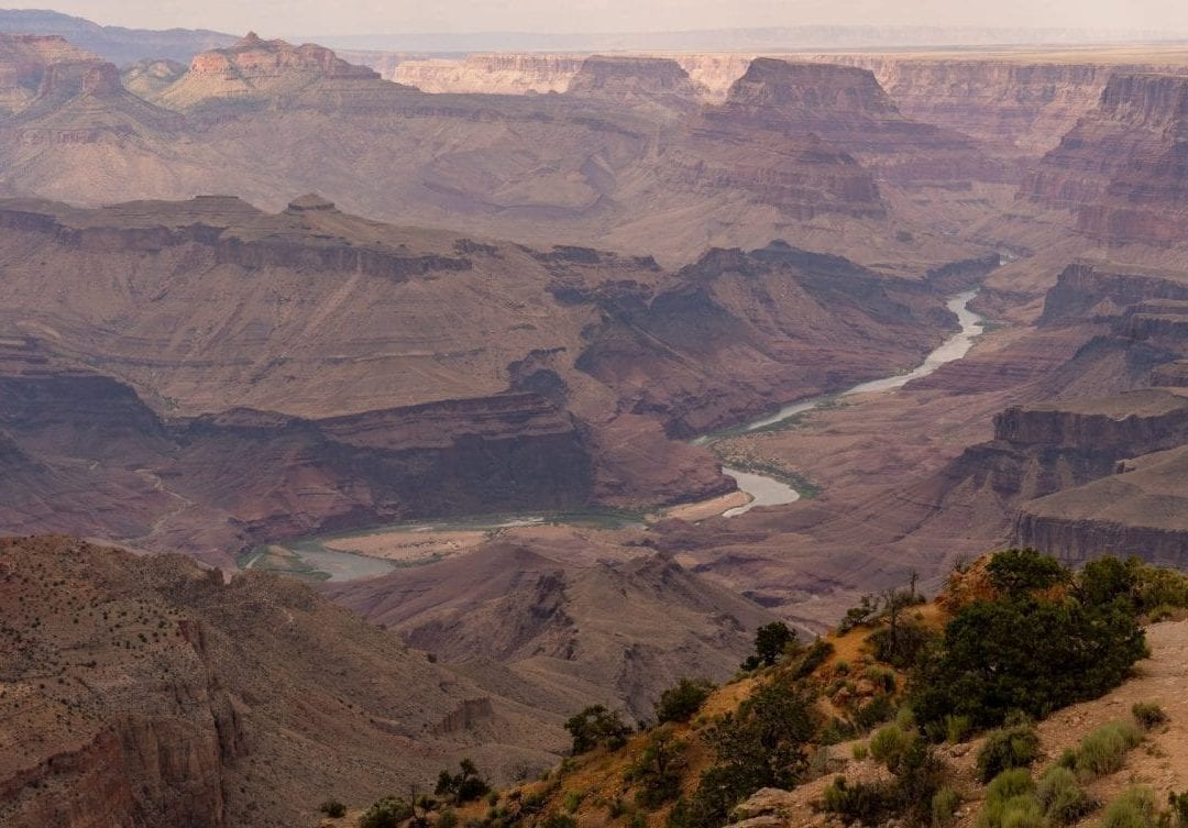 colorado river flowing at bottom of grand canyon
