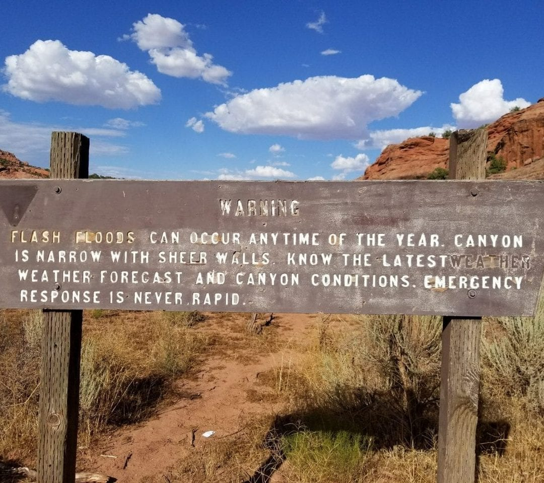 Sign posted at trailhead warning about flashfloods