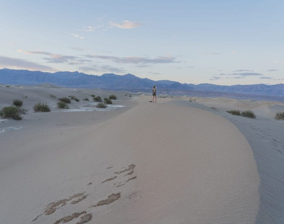 Walking on sand dunes, death valley
