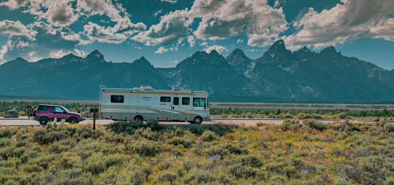 RV & Dinghy with backdrop of Grand Teton