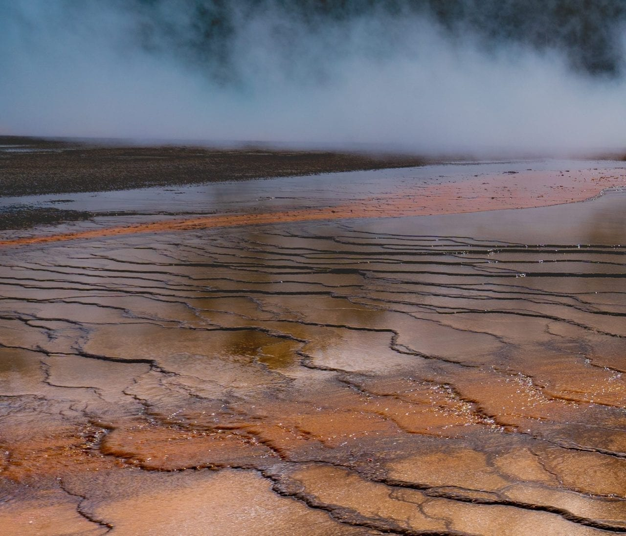 Vibrant orange layers surrounding Grand Prismatic Spring