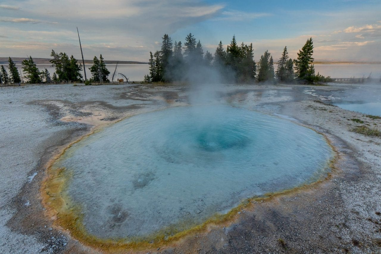 Geyser erupting in West Thumb area in Yellowstone